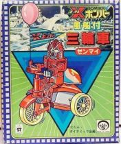 Bomber X - Big Dai X on a tricyle car wind-up toy