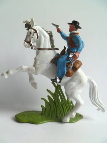 Britains Herald Cowboy Mounted with 2 pistols white rearing up horse (ref 60?)