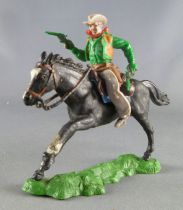 Britains Swoppets Cowboy Mounted with 2 pistols green shirt (ref 633)