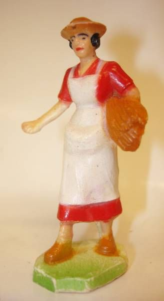 Clairet - farm - Farm woman giving seeds (red & white)