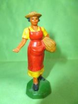 Clairet - farm - Farm woman giving seeds (yellow & red)