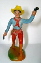 Clairet - wild west - cow boy 1st series - footed advancing two guns left arm up (blue & red)