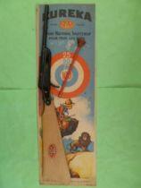 Eureka - Carabine tir aux pigeons avec flechette neuve sur carte Poulbot