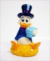 Scrooge - figure - Scrooge sat on his gold