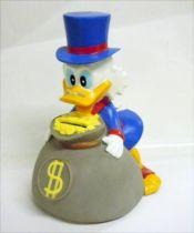 Scrooge - Merchandising - Vinyl Bank Scrooge holding a bag of gloden dollars
