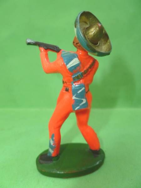 Starlux -  Gauchos - Series 53 - Footed Firing rifle standing (orange) (ref 241)