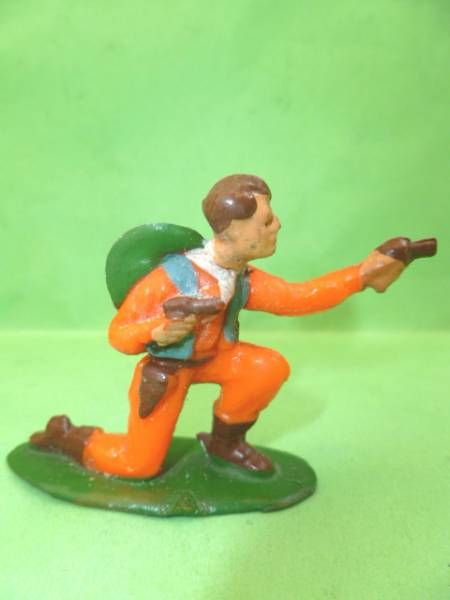 Starlux - Cow-Boys - Series 53 - Footed Kneeling firing gun (orange) (réf 124)