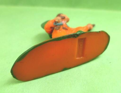 Starlux - Cow-Boys - Series 53 - Footed Kneeling firing gun (orange) (réf 124)