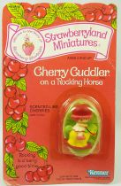 Strawberry shortcake - Miniatures - Cherry Cuddler on a Rocking Horse
