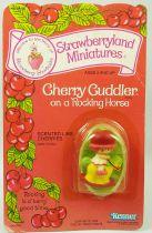 Strawberry shortcake - Miniatures - Cherry Cuddler on a Rocking Horse
