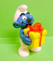 The Smurfs - Schleich - 20538 Smurf with yellow gift box