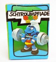 The Smurfs - Schleich - 40507 Olympic Smurf weight lifter (mint in box)