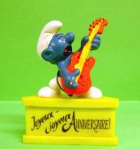 The Smurfs - Schleich - Smurf with bass \'\'Happy Birthday\'\' (yellow base)