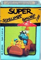 40232 Smurf driving a smurf mushroom car Mint in Box