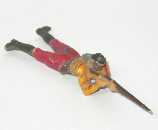 Clairet-  wild west - cow boy 1st series - footed laying firing rifle (yellow & red - no hat)