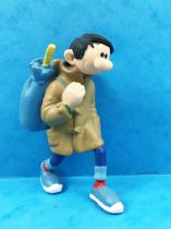 Gaston - Plastoy PVC Figure - Gaston with maroon Overcoat and Bundle