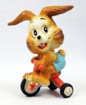 Lapin & Caneton - Figurine PVC Maia Borges - Lapin brun sur tricyle