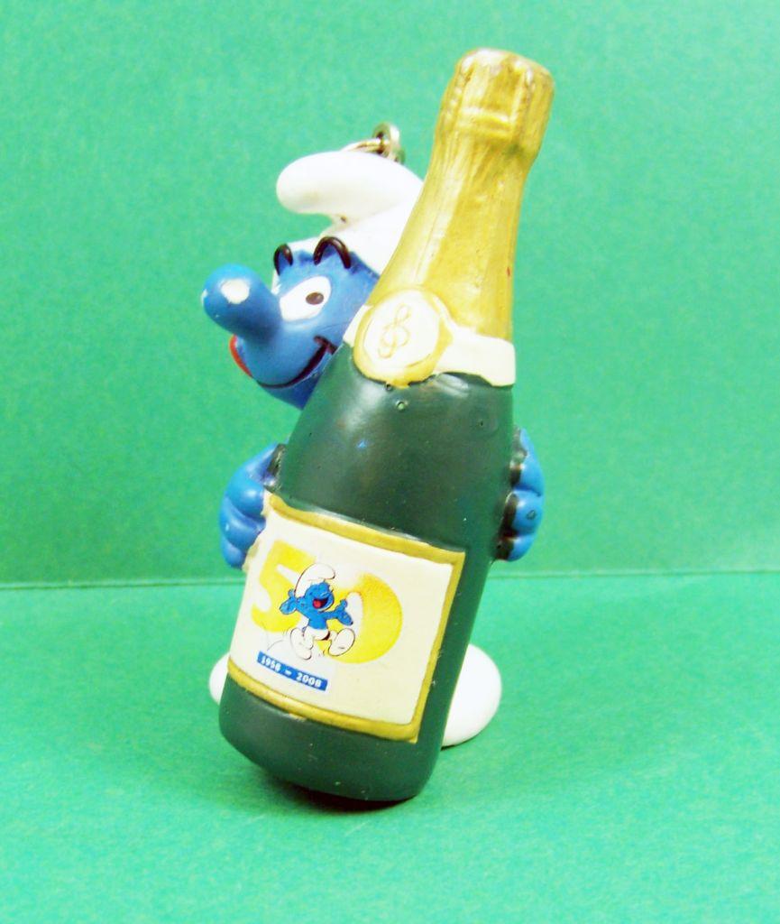 les_schtroumpfs___schleich___20708_serie_50eme_anniversaire__jubilee__schtroumpf_avec_champagne__porte_cles__02