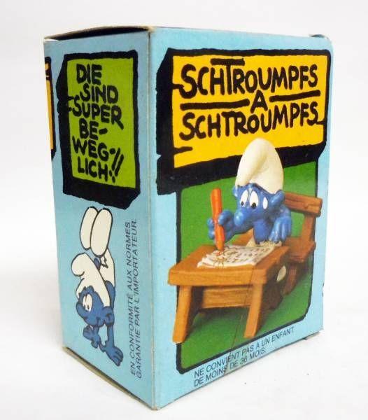 Les Schtroumpfs - Schleich - 40220 Schtroumpf écolier sur banc d\'école (neuf en boite)