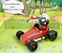 Les Schtroumpfs - Schleich - 40255 Schtroumpf avec voiture de course (rouge foncé)