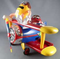 M&M\'s candy dispenser - Red and Yellow in plane