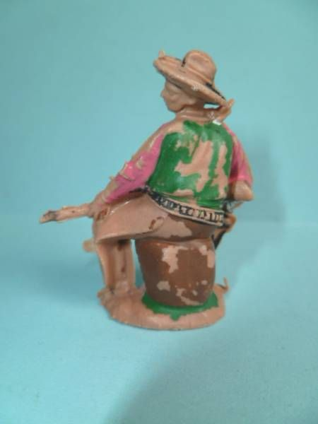 Reamsa - Wild West - Cow-Boys - Footed seated on barrel rifle in hand N° 67