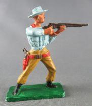 Starlux - Cow-Boys - Série 57 Ordinaire - Piéton Tireur fusil debout (bleu ciel & ocre) (réf 121)