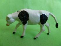 Starlux - La Ferme - Animaux - Veau broutant  sans socle (blanc & noir) (série ?? réf ????)