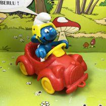 The Smurfs - Schleich - 40210 Smurf driving red car (yellow wheel)