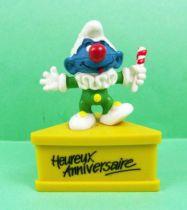 Les Schtroumpfs - Schleich - Schtroumpf clown \'\'Heureux Anniversaire\'\' (socle jaune) 01