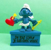 Les Schtroumpfs - Schleich - Schtroumpf  Cupidon De tout Coeur Je suis avec vous! (socle bleu) 01