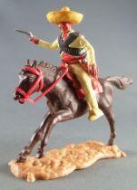 Timpo - Mexicains - Cavalier ceinture séparée bras droit tendu veste jaune révolver pantalon jaune sombrero jaune cheval brun