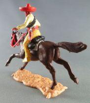 Timpo - Mexicains - Cavalier ceinture séparée pose du couteau veste jaune pantalon jaune citron sombrero rouge cheval brun galop