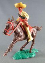 Timpo - Mexicains - Cavalier ceinture séparée pose du couteau veste jaune pantalon jaune sombrero jaune cheval brun galop court