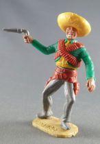 Timpo - Mexicains - Piéton bras droit tendu veste verte (révolver) sombrero jaune jambes grises pied droit vers la droite