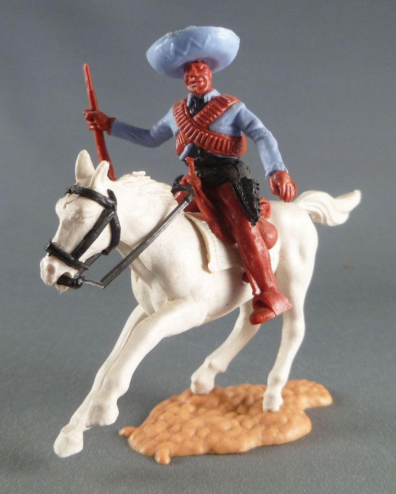 Timpo - Mexicans - Mounted (moulded belt) right arm pointing blue jacket (winchester) brown legs blue hat white galloping (short