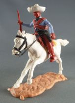 Timpo - Mexicans - Mounted (moulded belt) right arm pointing blue jacket (winchester) brown legs white hat white galloping (long