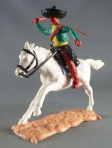 Timpo - Mexicans - Mounted (moulded belt) right arm raised green jacket (whip) brown legs black hat white galloping (long) horse