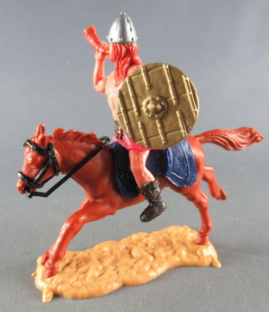 Timpo - Viking - Cavalier Sonneur de cor (roux) jupe rouge bouclier doré selle bleue cheval marron galop (long)