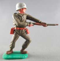 Timpo - WW2 - Americans - 1st series - Firing rifle waist standing leaning to the left legs