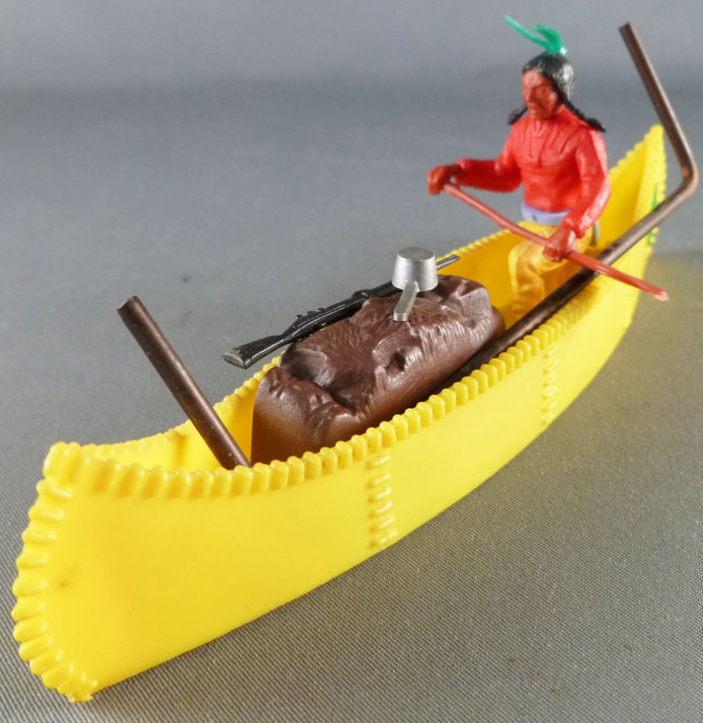 Timpo Indians 3rd series (1 piece head - knife belt) Canoe (Cargo yellow) fig. paddle on left red shirt yellow pants green feath