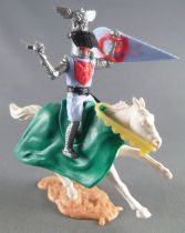 Timpo Middle-Age Great Helm Knight mounted blue light & red (black visor) white galloping (short) horse (green cloak)